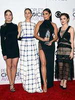 """Ashley Benson, Troian Bellisario, Shay Mitchell and Lucy Hale, winners of Favorite Cable TV Drama for """"Pretty Little Liars"""", pose in the press room during the People's Choice Awards. Picture: Getty"""