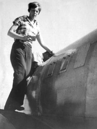 Amelia Earhart working on her plane in Darwin. Picture: The Mail