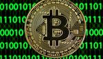 "(FILES) In this file photo taken on January 26, 2020 a physical imitation of a Bitcoin is seen in Dortmund, western Germany. - Tesla began officially accepting bitcoin as currency to purchase electric autos, Chief Executive Elon Musk said on March 24, 2021 a with bitcoin,"" Musk said on Twitter, implementing a plan announced in February to accept the cryptocurrency as a form of payment. (Photo by INA FASSBENDER / AFP)"