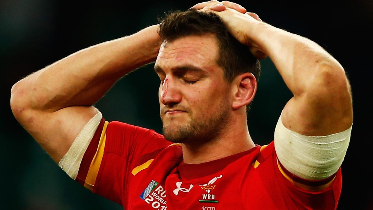 Sam Warburton of Wales holds his head in his hands and looks dejected.