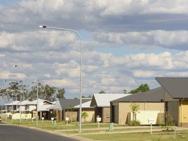 A row of brand new, vacant houses in Moranbah, where prices have plummeted after coal prices fell. Picture: Robyne Cuerel