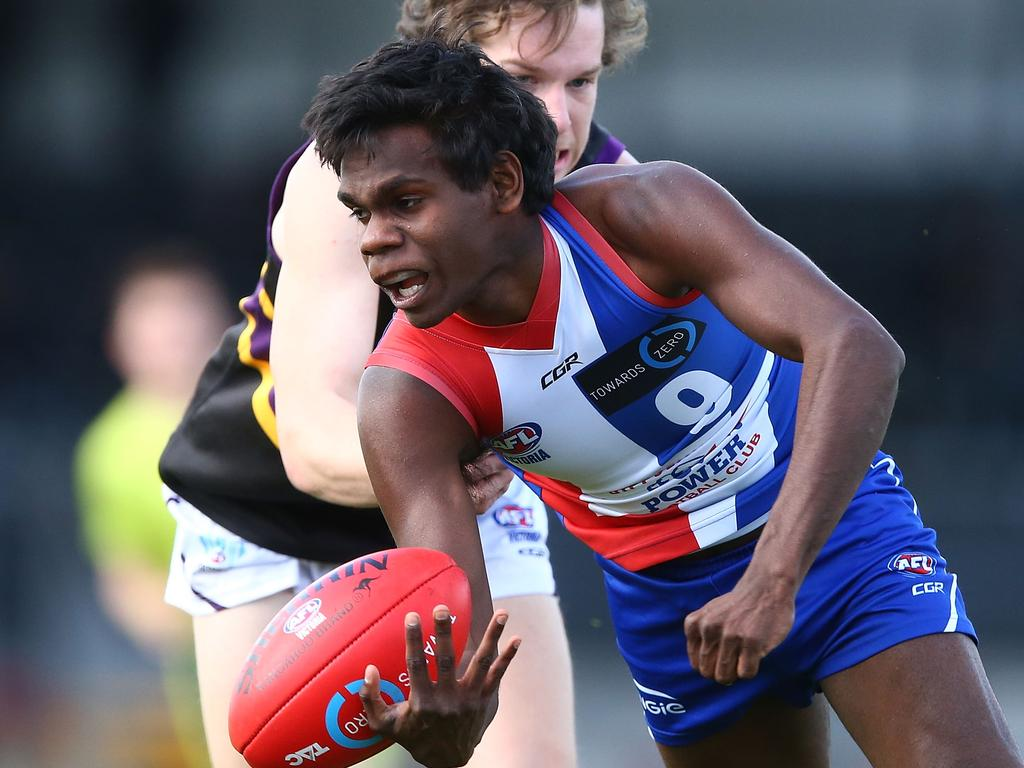 MELBOURNE, AUSTRALIA - SEPTEMBER 03: Irving Mosquito of the Power is tackled during the TAC Cup round 18 match between Gippsland and Murray at Victoria Park on September 3, 2017 in Melbourne, Australia. (Photo by Jack Thomas/AFL Media/Getty Images)