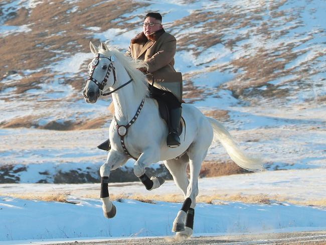 This undated picture shows Kim Jong-un riding a white horse among the first snow at Mount Paektu. Picture: STR/KCNA VIA KNS/AFP