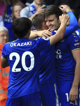 Leicester City's Harry Maguire (R)