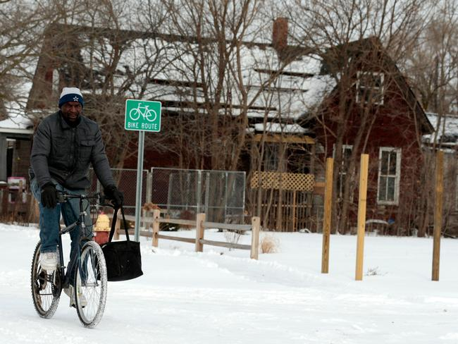 Jerry Jackson rides his bike in Detroit, Michigan on Tuesday. Picture: Jeff Kowalsky/AFP