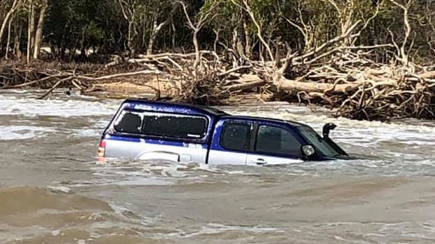 A Top End fisho's 4WD has gone for a swim in the mouth of the Finniss River. Picture: Facebook/@fishing.reports.darwin