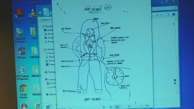 Ufologist Bryan Dickeson shows UFO society guests diagrams of aliens as described and sketched in witness reports.