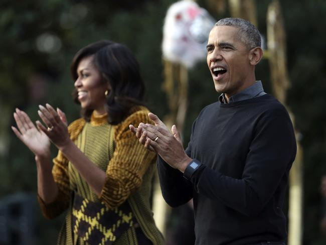 Barack and Michelle Obama hosted a trick-or-treat celebration for local children at the White House this year. Picture: Manual Balce Ceneta/AP