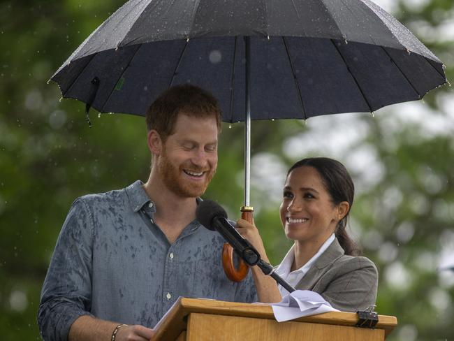 Prince Harry, Duke of Sussex and Meghan, Duchess of Sussex address the public during a Community Event at Victoria Park in Dubbo, Australia. Picture: Getty