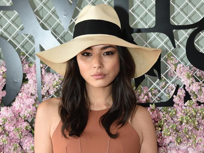 Jessica Gomes keeps it simple with a wide brimmed hat at the Caulfield Cup. Picture: AAP/Julian Smith.