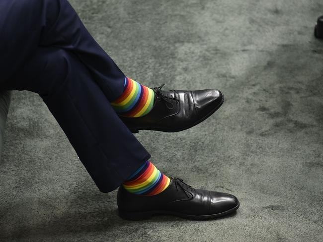 Mark Dreyfus shows support for the marriage equality bill by wearing colourful socks at Parliament House on December 7. Picture: Michael Masters/Getty Images