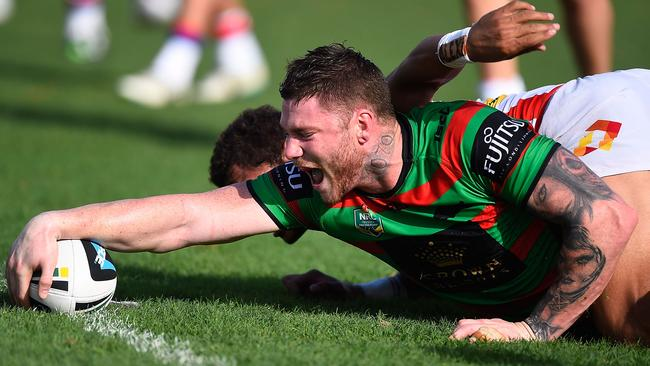 Chris McQueen reaches out to scores a try