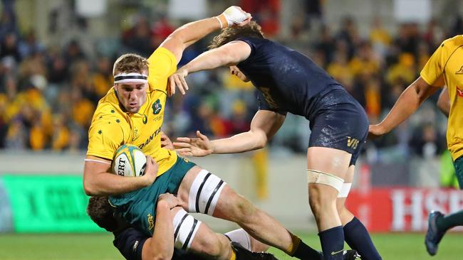 Izack Rodda of the Wallabies is tackled against Argentina at Canberra Stadium.