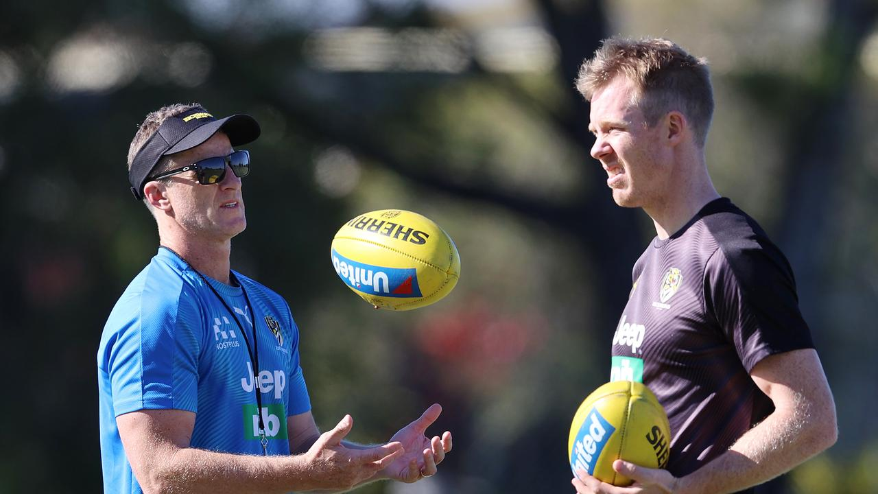 Riewoldt and coach Damien Hardwick chat during training on the Gold Coast.