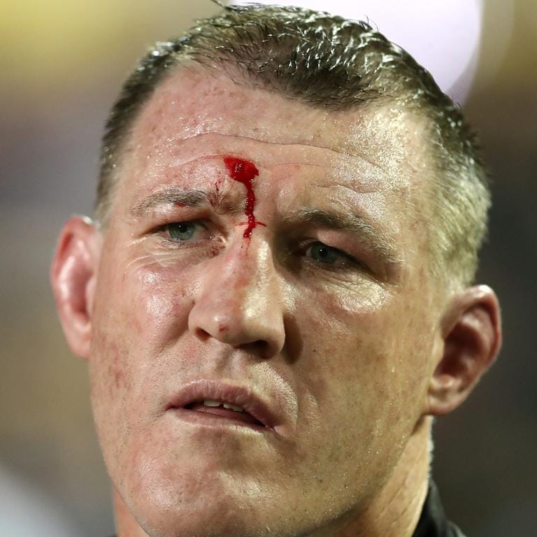 Paul Gallen of the Sharks watches on from the sideline