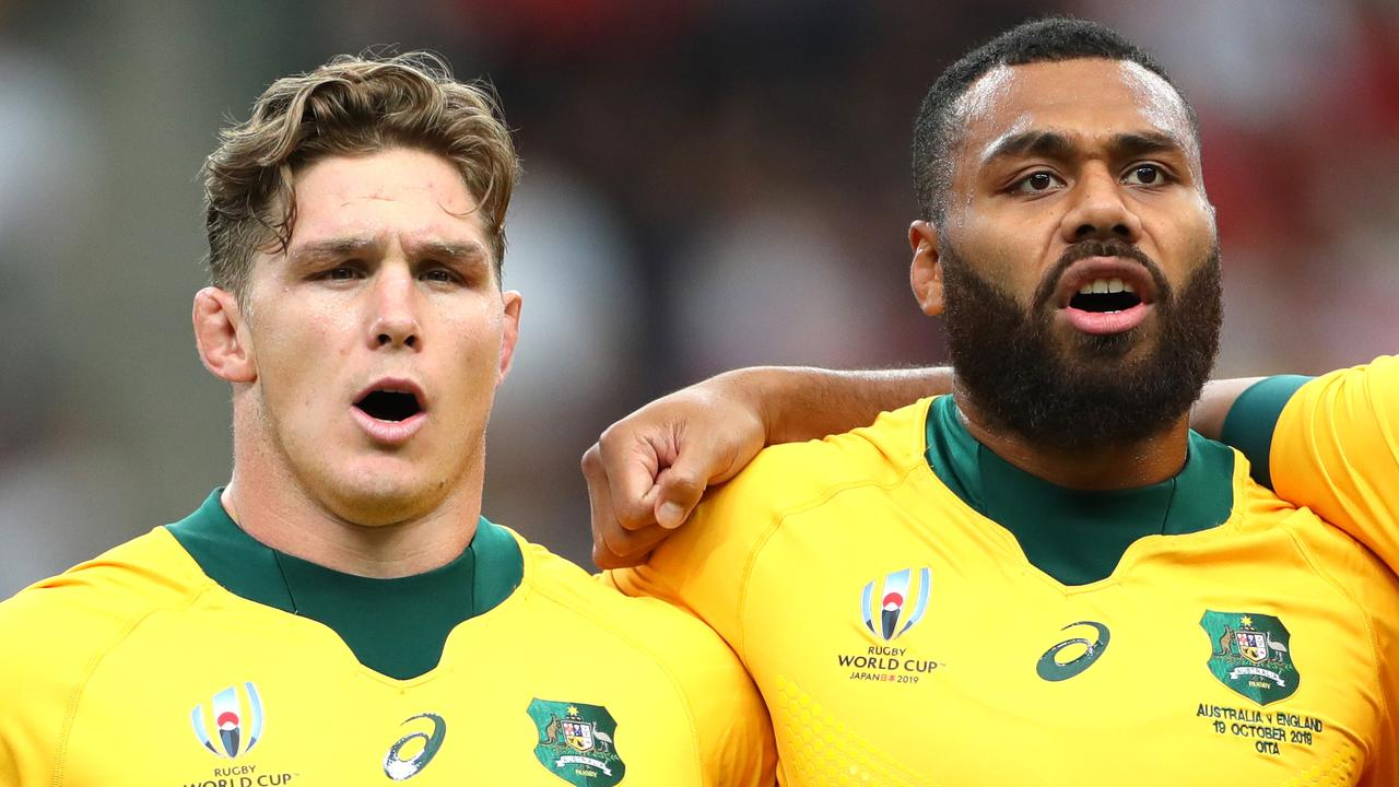 Michael Hooper and Samu Kerevi line up for the national anthem at Oita Stadium.