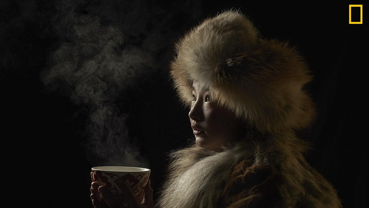 "The winner of the People category, titled ""Tea culture"". The photographer visited a Kazakh family of Golden Eagle hunters in Western Mongolia. Tea is an important part of the Kazakh culture. Picture: Alessandra Meniconzi"