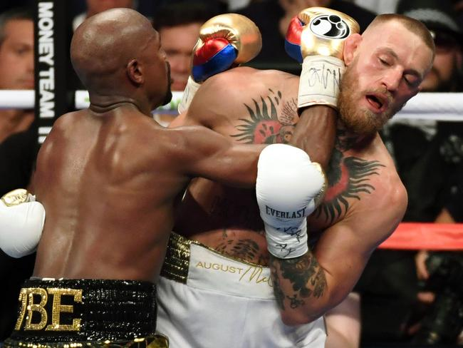 Floyd Mayweather ran over the top of McGregor.