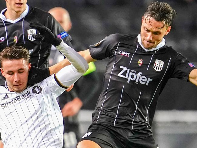 LASK's Aussie midfielder James Holland, right, in action against Rosenborg's Anders Trondsen during their Europa League match last week. Picture: AP