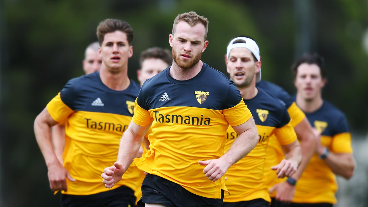 Tom Mitchell has received some advice from Gary Rohan and Michael Barlow.