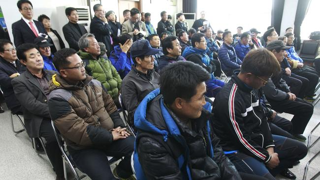 Salt farms owners and workers attend a meeting with lawmakers as a part of human rights inspection on Sinui Island, South Korea. (AP Photo/Ahn Young-joon)