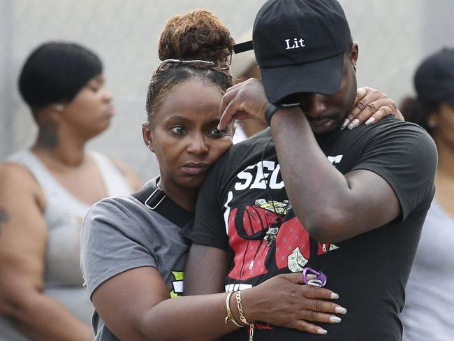 A man wipes his eyes outside a Chicago hospital packed with family and friends of shooting victims last Sunday. Picture: Antonio Perez/Chicago Tribune via AP