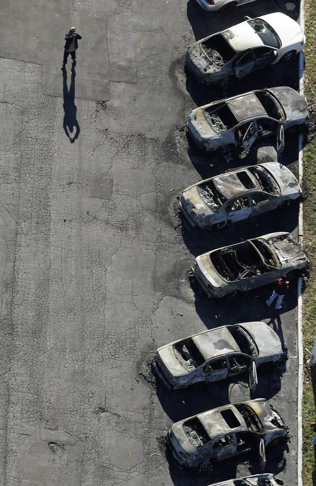Destruction ... A row of charred cars at a used car dealership in Dellwood, Missouri., after they were burned in overnight protests. Source: AP