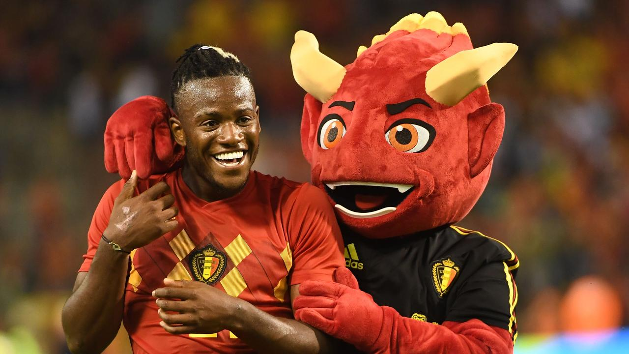 Friends forever? Belgium's Red Devil mascot (right, if it wasn't obvious), with forward Michy Batshuayi.