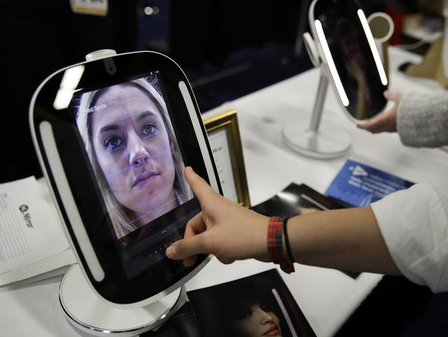 The HiMirror Mini analyses user's faces and identifies dark circles around their eyes, red or dark spots, wrinkles, pores, and skin smoothness and gives them a rating and recommendations. Picture AP