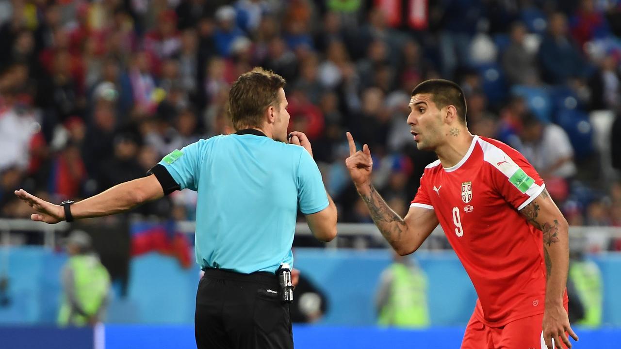 Serbia's forward Aleksandar Mitrovic argues with referee Felix Brych.