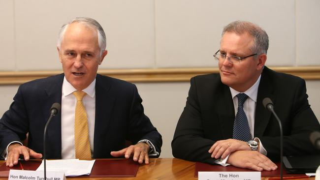 Prime Minister Malcolm Turnbull and Minister for Social Services Scott Morrison at Parliament House in Canberra. Mr Morrison has been tipped to take on the new role of Treasurer.