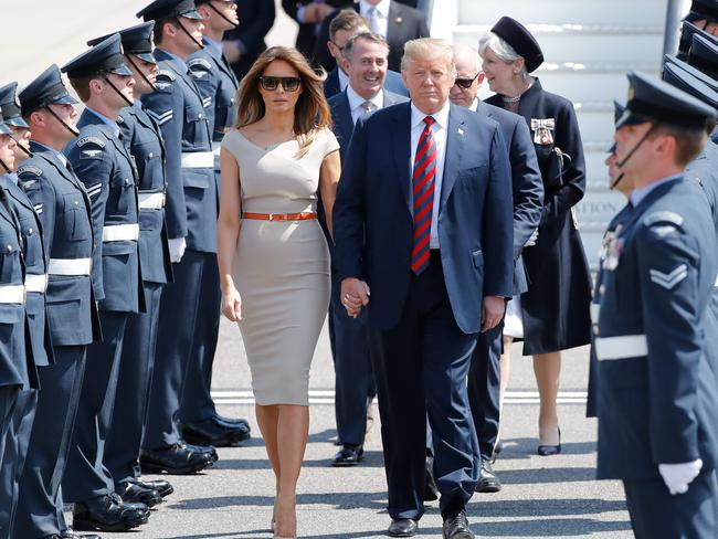 Mr Trump, pictured arriving in Britain with wife Melania, boasted that the other NATO nations had agreed to his demands — but they said they had simply reaffirmed existing commitments. Picture: AFP Photo / Tolga Akmen