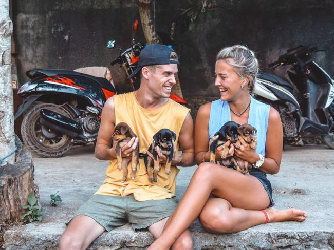 Charlie and Lauren with puppies at Nusa Lembongan, Indonesia.