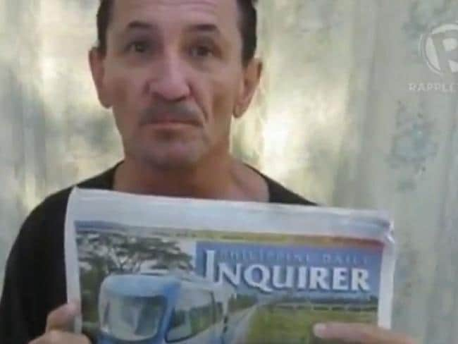 Held against his will ... in another Facebook post Australian Warren Rodwell holds an Inquirer issue dated Jan 25, 2012. Picture: Facebook