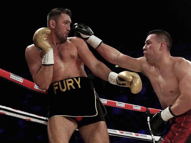Joseph Parker (R) throws a right at Hughie Fury during the WBO heavyweight title boxing bout.