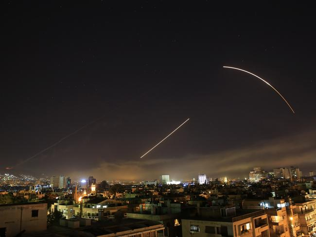 Missiles streak across the Damascus skyline as the US launches an attack. Picture: AP