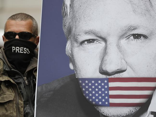 A supporter of Julian Assange, with a poster of the WikiLeaks founder, protests in London. Picture: AP