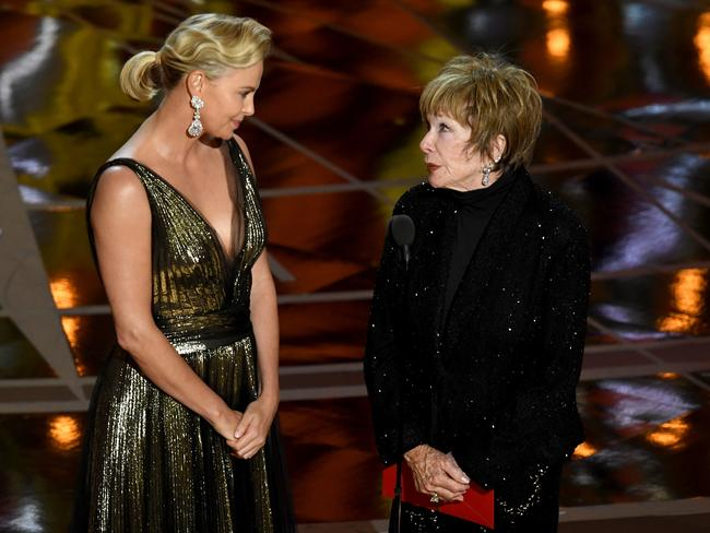 Charlize Theron and Shirley MacLaine presenting at the 89th Academy Awards.