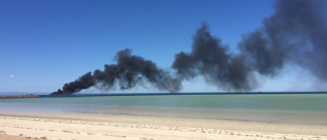 The fire sends a huge plume of black smoke into the air. Picture: Andrew Story