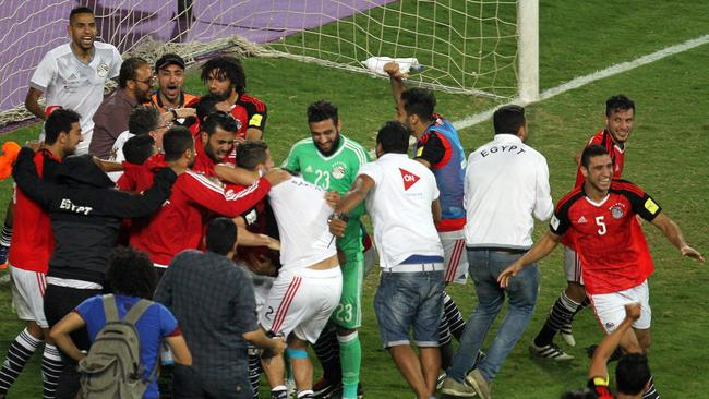 Egypt's team players celebrate qualifying for Russia