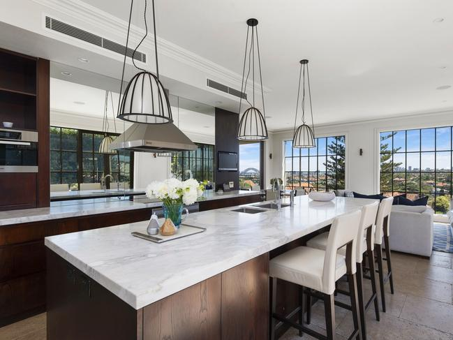 The designer kitchen has a breakfast bar and high quality finishes.