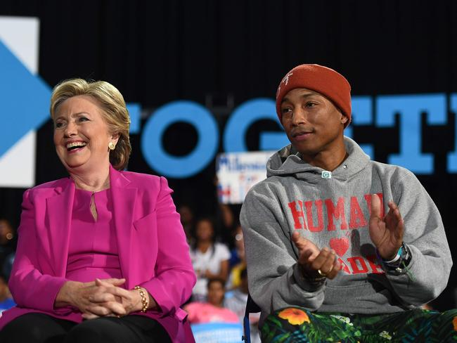 US Democratic presidential nominee Hillary Clinton and singer Pharrell Williams listen to Bernie Sanders during a campaign rally in North Carolina on November 3, 2016. Picture: AFP
