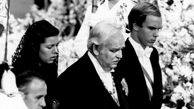 Prince Rainier and children Prince Albert and Princess Caroline attend the funeral of Princess Grace of Monaco.