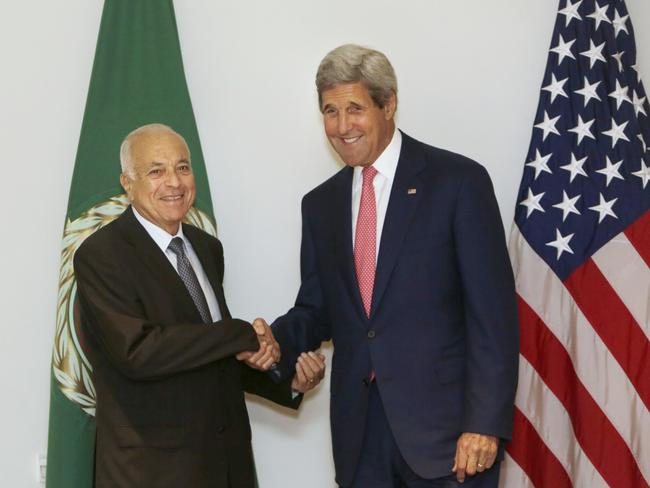 Seeking support for increasing its attack on the Islamic State terrorist ... US Secretary of State John Kerry, right, shakes hands with Secretary-General of the Arab League, Nabil Elaraby before their meeting in Cairo, Egypt. Picture: Amr Nabil