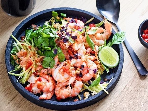 A simple salad can turn prawns into a tasty new meal by adding a fresh ingredient like mango. Picture: Supplied