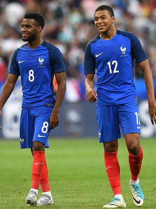France's Thomas Lemar (L) and Mbappe.