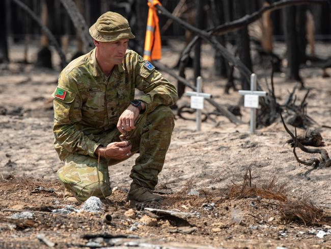 Lieutenant Kynan Lang visits the site where his uncle Dick and cousin Clayton were killed in the bushfire. Picture: Brad Fleet