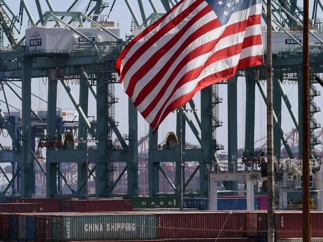 The US flag flies over Chinese shipping containers unloaded at the Port of Long Beach, in Los Angeles County. Picture: AFP