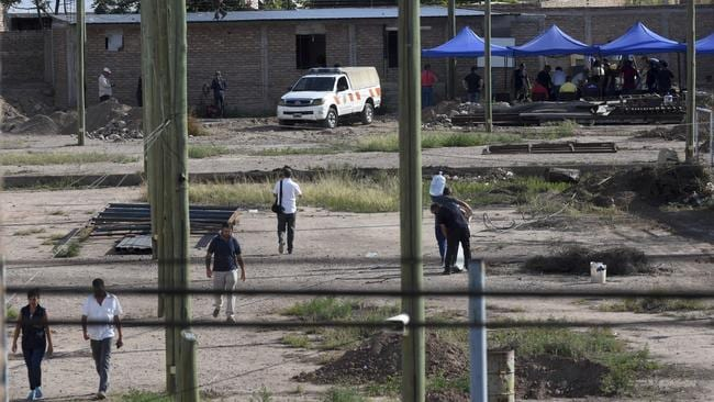 Police work in the lot next to the home of Gilad Pereg where the bodies of his mother and aunt were found in Mendoza, Argentina. Picture: Gustavo Roge