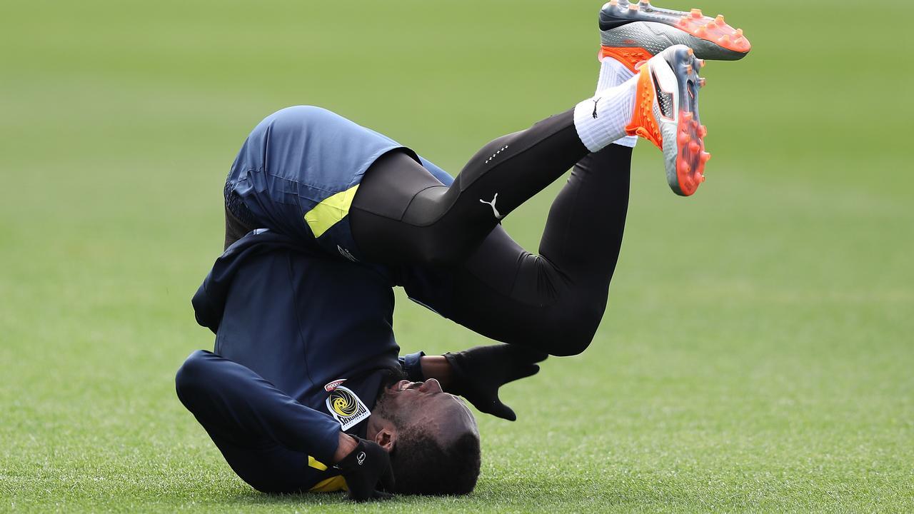 Usain Bolt takes a tumble during training.